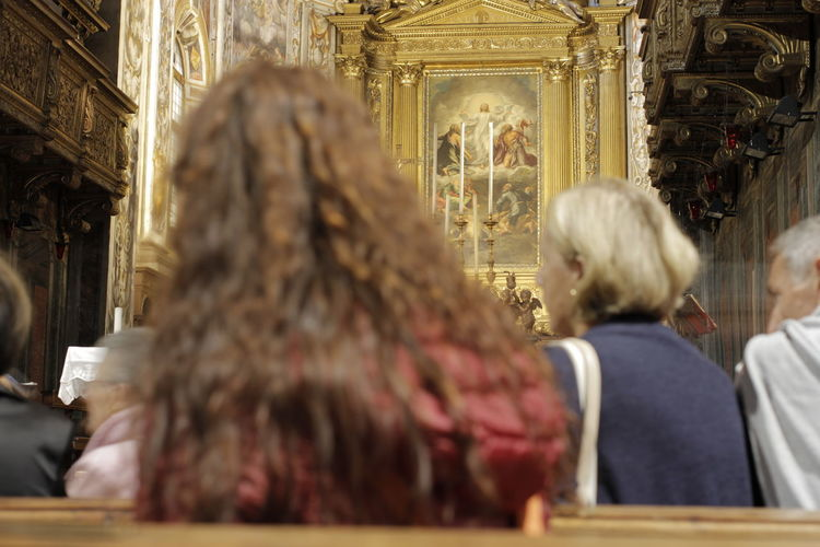 Rear view of people in temple