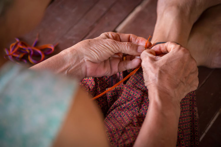 Traditional weavers Adult Art And Craft Close-up Craft Creativity Hand Holding Human Body Part Human Hand Indoors  Knitting Knitting Needle Midsection One Person Real People Selective Focus Senior Adult Skill  Textile Wool