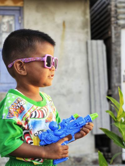 Full length of boy holding camera
