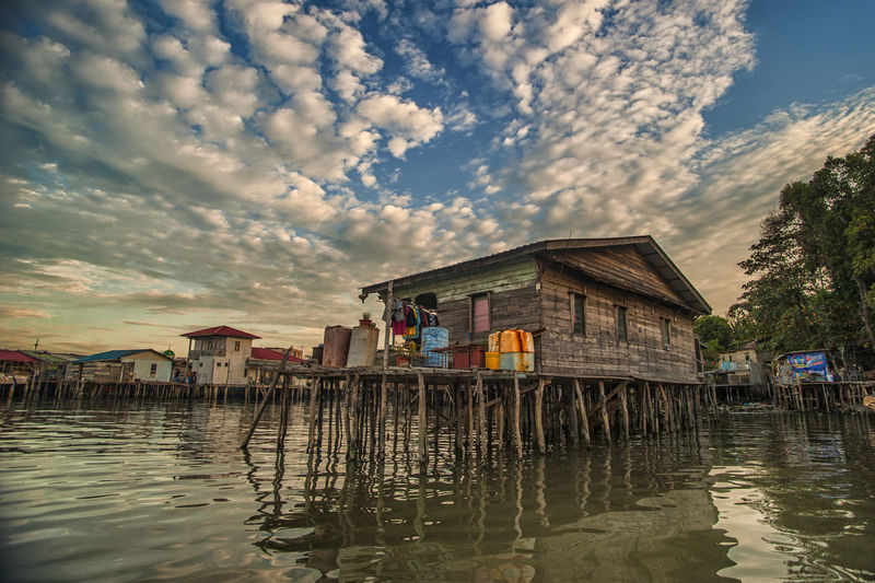 Stilt houses on sea during dusk