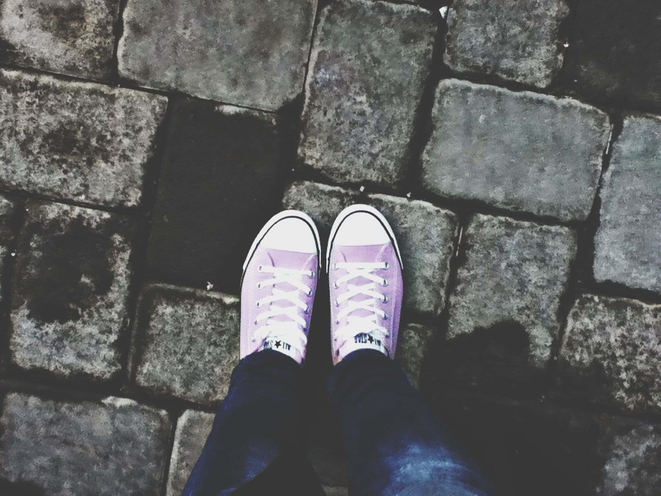 low section, person, shoe, personal perspective, standing, human foot, high angle view, lifestyles, footwear, jeans, men, street, cobblestone, unrecognizable person, leisure activity, paving stone, outdoors