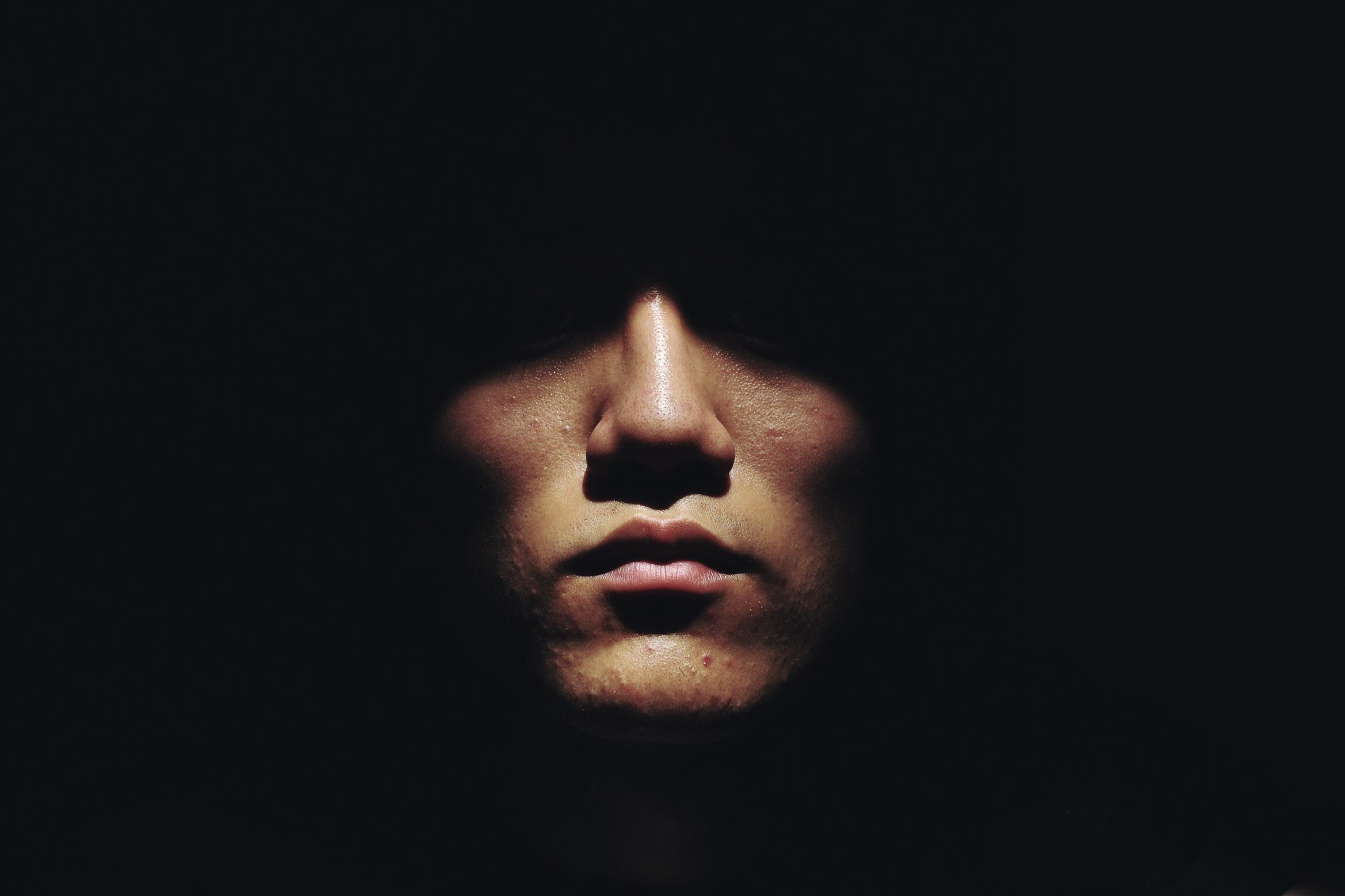 studio shot, black background, copy space, person, close-up, indoors, part of, red, dark, cut out, holding, darkroom, single object, night, burning, human finger