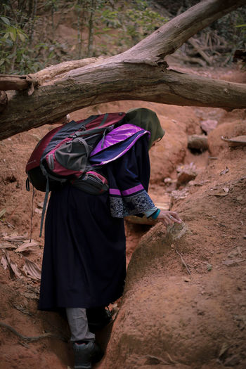 Woman on rock in forest