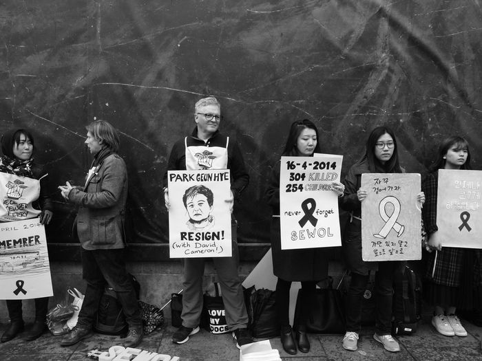 Sewol Ferry silent Protest London. 16-04-2016. Families Calling for the South Korean Government to raise the sunken wreckage and the remains of their relatives..... Grief London London Protests Olympus Protest Sewol Ferry Disaster Silent Protest  South Korea Steve Merrick Stevesevilempire Trafalgar Square Zuiko