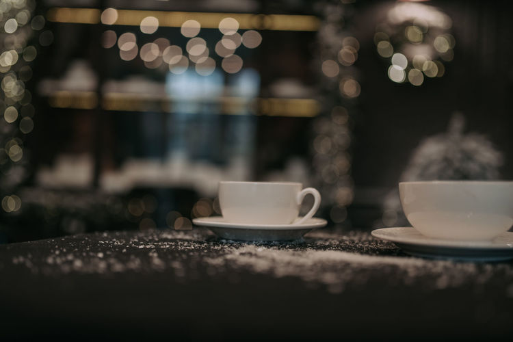 Coffee cup on table in cafe