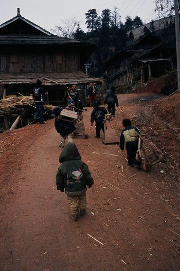 Rear view of people walking on building