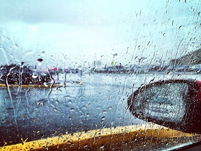 Wet Rain Water Drop Weather Rainy Season RainDrop Window Monsoon Day Vehicle Interior Road Nature Outdoors No People Close-up Sky Rainy Days Driving In The Rain Adapted To The City