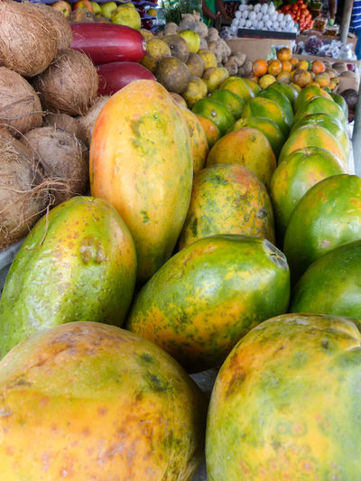 Abundance Belize  Choice Close-up Coconuts Collection Day Display Food Freshness Fruit Full Frame Green Color Healthy Eating Heap Market Market Stall Multi Colored No People Organic Papaya PawPaw Ripe Sale