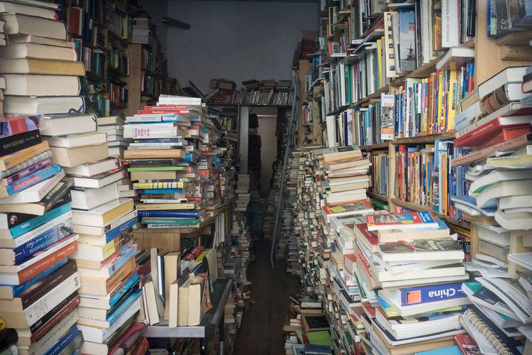 Room full with books in shelves and on tables Abundance Antiquities Arrangement Books Buy Collector Everywhere Full High Lots No People Obsession Old Reading Repetition Second Hand Sell Shelf Stack Store Table