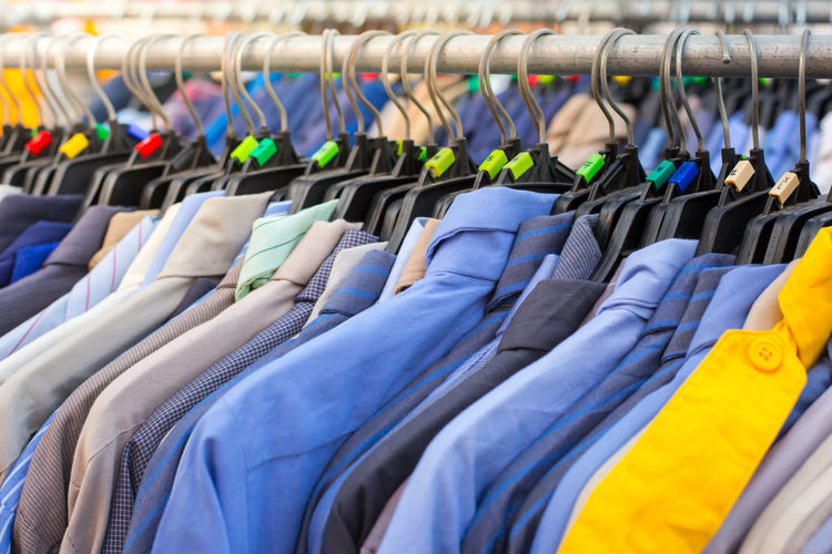 Many shirts hanging on a rack in cloth shop Arrangement Boutique Business Choice Clothes Rack Clothing Coathanger Collection Consumerism Fashion Hanging In A Row Large Group Of Objects Multi Colored No People Order Rack Retail  Retail Display Sale Shopping Side By Side Store Textile Variation