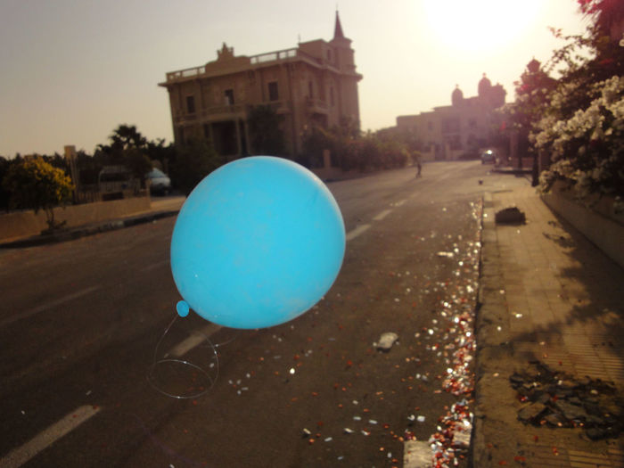 After a parade here in Cairo, there was a lone balloon flying in the streets.