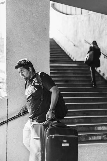 Wait for me, guys Casual Clothing Heavy Lifestyles Luggage Luggage, Travel  Magnumphotos One Person People Portrait Real People Steps Streetphoto_bw Suitcase Three Quarter Length The Street Photographer - 2017 EyeEm Awards