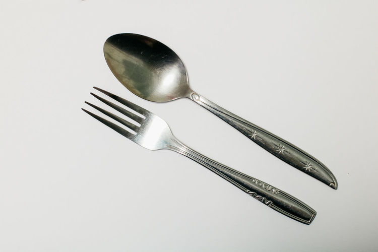 Studio Shot Metal Indoors  Kitchen Utensil Eating Utensil White Background Silver Colored Household Equipment Fork Still Life Steel High Angle View Close-up No People Spoon Silverware  Stainless Steel  Cut Out Alloy Single Object Table Knife Crockery