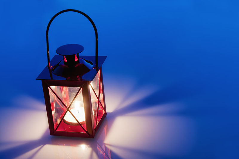 Decorative red metal lantern Blue Close-up Day Electric Lamp Electric Light Focus On Foreground Illuminated Lamp Lighting Equipment Low Angle View Multi Colored No People Sky