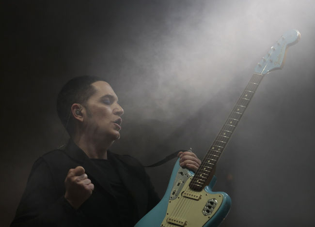 Brian Molko, Placebo Arts Culture And Entertainment Brian Molko British Electric Guitar Fretboard Guitar Holding Music Musical Instrument Musician One Person People Performance Placebo Playing Rock Music Singer  Young Adult