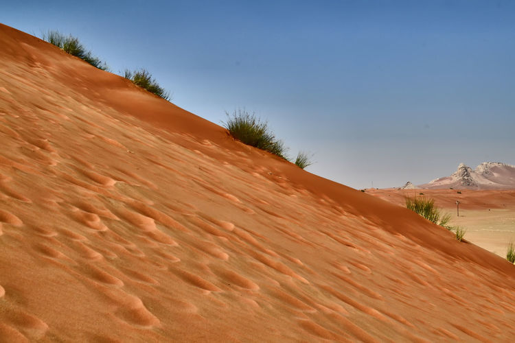 Desert Arid Climate Beauty In Nature Climate Day Desert Environment Land Landscape Mountain Nature No People Non-urban Scene Outdoors Remote Sand Sand Dune Scenics - Nature Sky Sunlight Tranquil Scene Tranquility