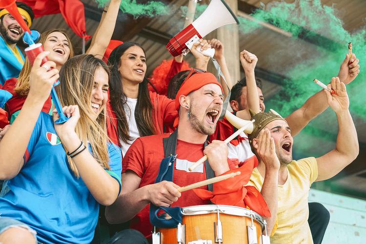Fans cheering in stadium