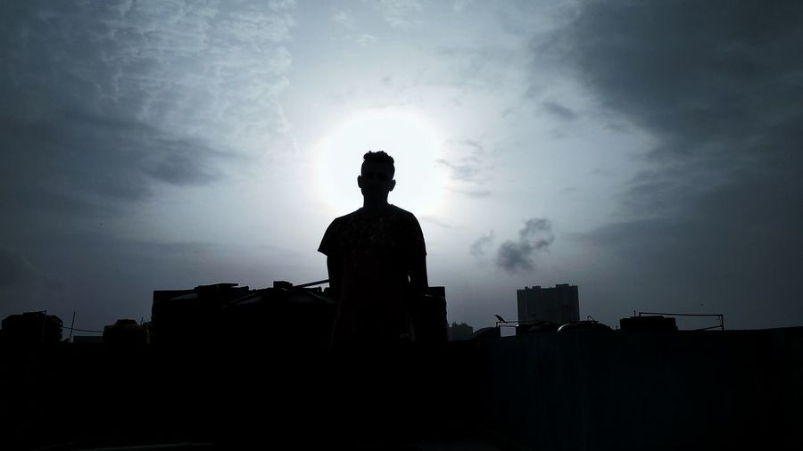 Low angle view of man against building against sky