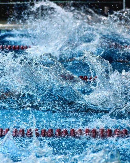 Close-up of water splashing in swimming pool