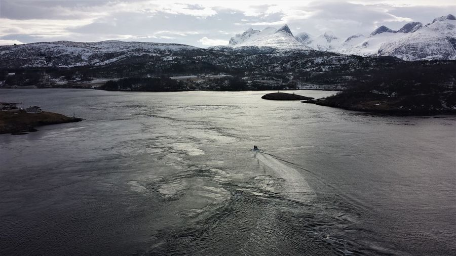 Beauty In Nature Boat Bodø Cold Temperature Day Fjord Frozen Ice Iceberg Lake Landscape Mountain Nature No People Outdoors Saltstraumen, View From Bridge Sea Sky Snow Tranquility Water Winter Perspectives On Nature