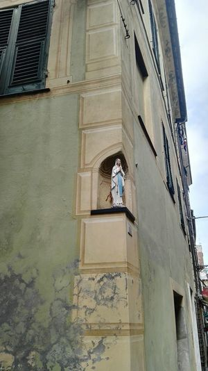 Albenga Architecture Architecture Balcony Blue Building Building Exterior Built Structure City Day Façade Full Length Human Representation Low Angle View Madonna Men Outdoors Religion Residential Building Residential Structure Sky Window