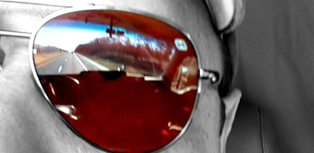Reflection In Sunglasses Of Road Ahead California Coast Capturing Freedom