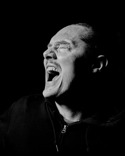 scream Mouth Open Mouth Studio Shot Black Background One Person Shouting Negative Emotion Emotion Adult Frustration Aggression  Facial Expression Furious Anger Headshot Scream Screaming Rock Music Metal Music Death Metal Exasperation Fury Hatred Rage Temper Angry One Man Only Black & White Eyes Closed  Irritation Men Portrait Light And Shadow Shadows & Lights The Portraitist - 2019 EyeEm Awards My Best Photo