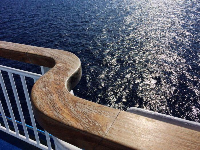 Close-up of railing against sea