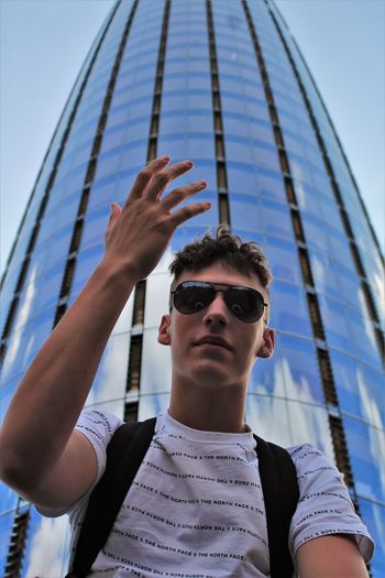 Low angle view of teenage boy against tower