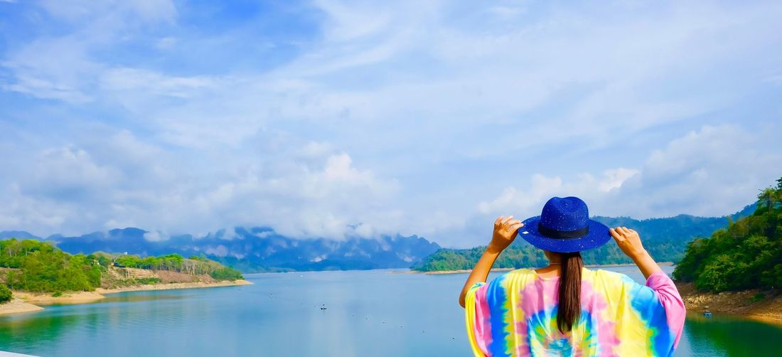 Water Sky Cloud - Sky One Person Sea Beauty In Nature Mountain Real People Lifestyles Women Scenics - Nature Rear View Standing Leisure Activity Nature Day Beach Land Outdoors Human Arm