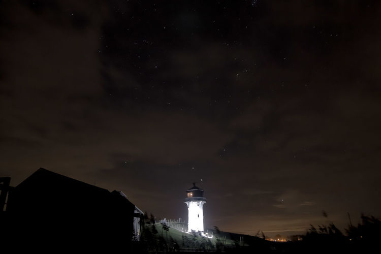 lighthouse at night Lights Lighthouse Night Nightphotography Night Lights No People Sillouette Star - Space Star Astronomy Star - Space Constellation Clock Face City Lighthouse Galaxy Illuminated History Sky Astrology Sign Sagittarius Astrology Star Field Space And Astronomy Maritime Provinces Star Trail Infinity Taurus Starry Milky Way
