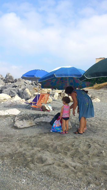 Bambino italiano :) Adult Bambino Beach Beauty In Nature Day Italy Men Mountain Nature Outdoors People Real People Sand Sky Snap A Stranger Street Photography Streetphotography Sunlight Togetherness Two People Vacations Water Women