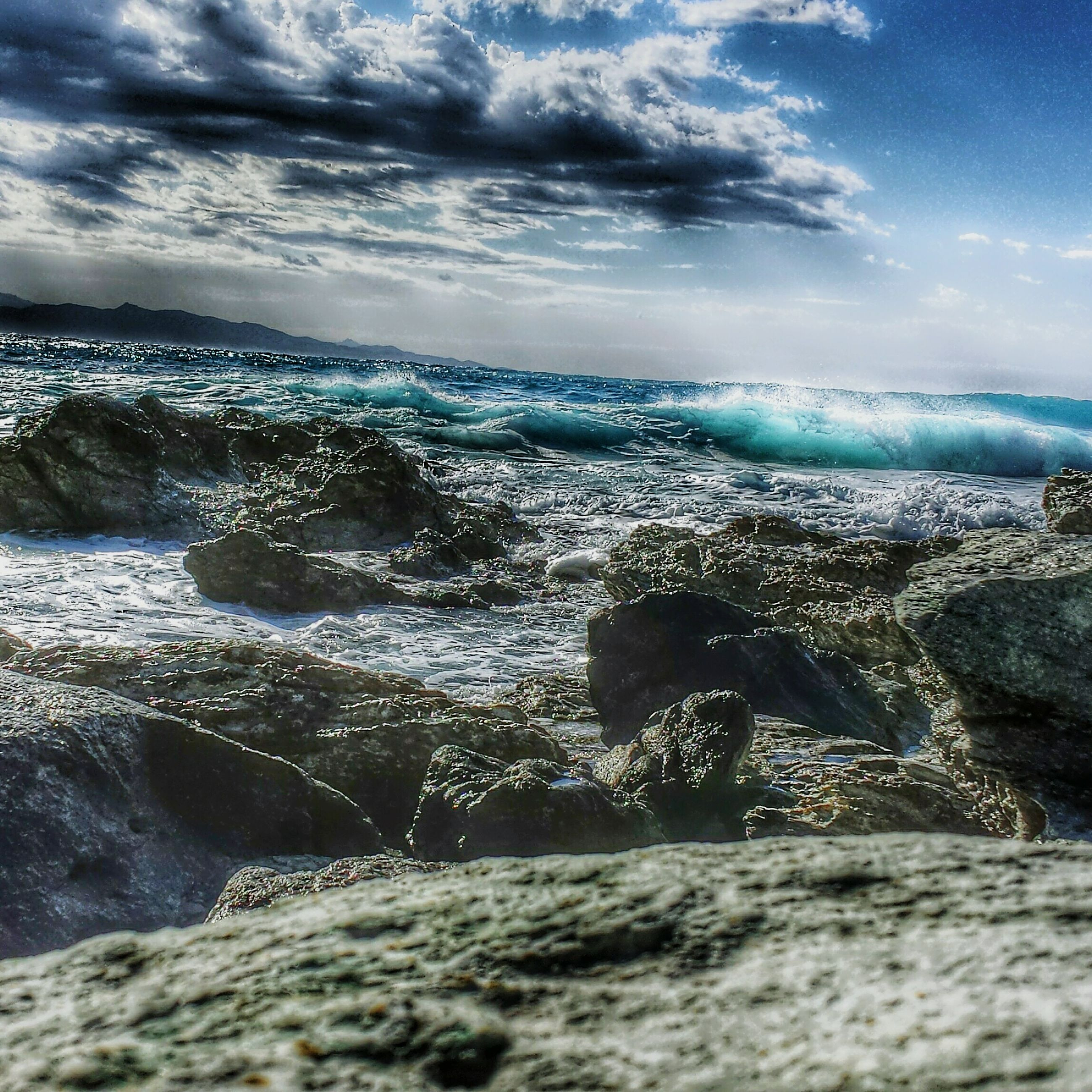 sea, water, sky, beach, scenics, shore, cloud - sky, wave, beauty in nature, horizon over water, tranquil scene, nature, tranquility, surf, sand, cloud, motion, cloudy, rock - object, idyllic