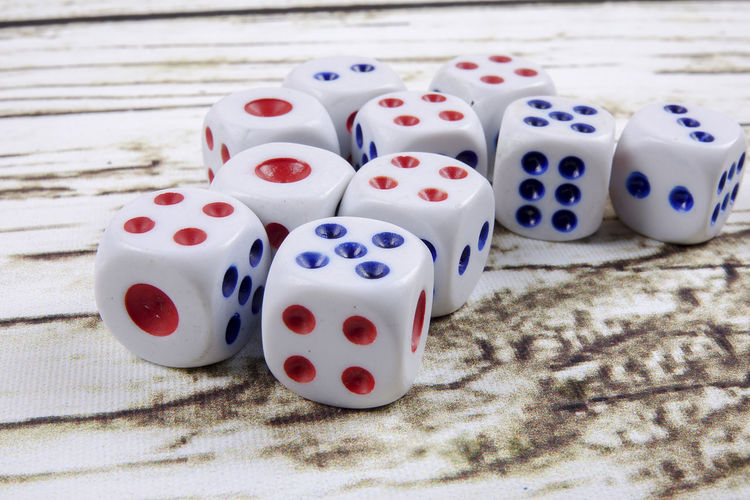 DICES ON A WOODEN TABLE Arts Culture And Entertainment Close-up Dice Five Objects Gambling Game Of Chance Group Of Objects High Angle View Indoors  Leisure Activity Leisure Games Luck Medium Group Of Objects No People Number Opportunity Relaxation Still Life Table White Color Wood - Material