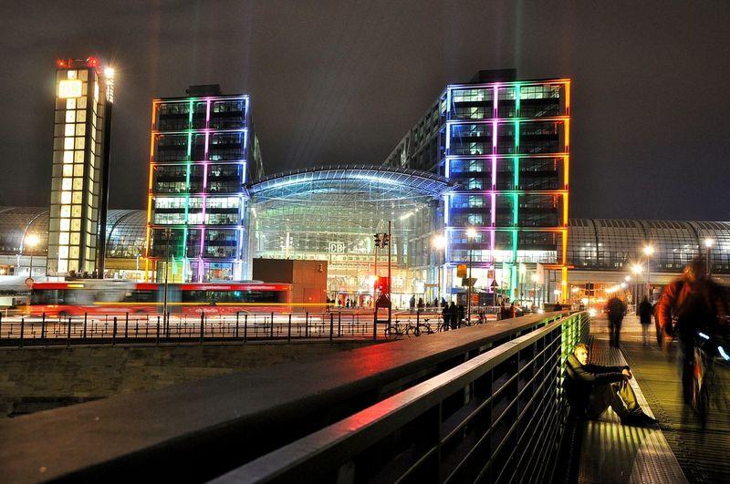 Illuminated Berlin Hauptbahnhof In City Against Sky At Night