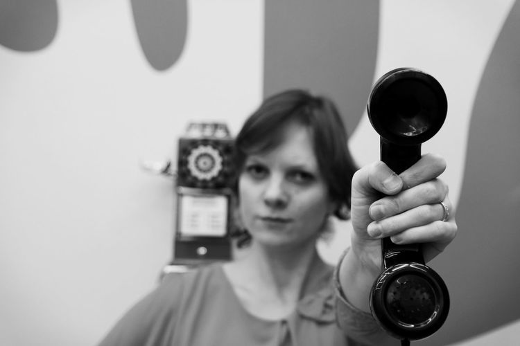 Portrait of woman holding camera