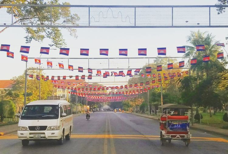 Morning vibes at Siem Reap Road Outdoors Transportation Land Vehicle Day City People Tree Adult Sky Morning Landscape Siemreap Cambodia Travel Destinations Photography Landscape_Collection Conected Whit Travel Tukutuk Traditionalvehicle Southeastasia Indochina Takenbyme Cityscape City Life