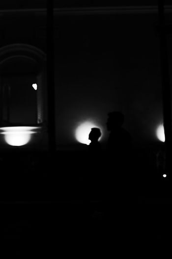 Silhouette people standing at night