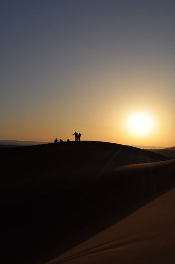 Mar 2011 Desert Morocco Ouarzazate Travel Beauty In Nature Clear Sky Day Desert Landscape Men Nature One Person Outdoors People Real People Sand Sand Dune Scenics Silhouette Sky Sun Sunlight Sunrise Sunset