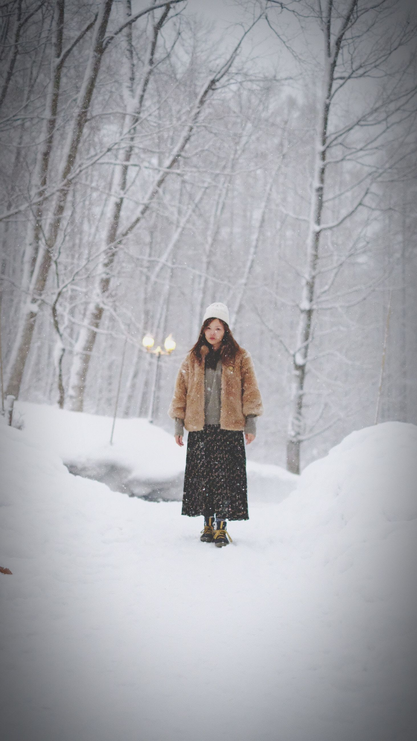 winter, cold temperature, snow, one person, warm clothing, women, portrait, nature, young adult, one woman only, only women, young women, forest, adult, adults only, tree, people, standing, one young woman only, beautiful woman, cardigan sweater, scarf, beauty, smiling, females, outdoors, beauty in nature, mountain, day, human body part, desaturated