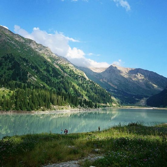Mountain Lake Water Mountain Range Beauty In Nature Nature Travel Outdoors Landscape Day Hiking Vacations Pine Tree Travel Destinations Kazakhstan Almaty Scenics Pinaceae Sky Tree Grass Adventure