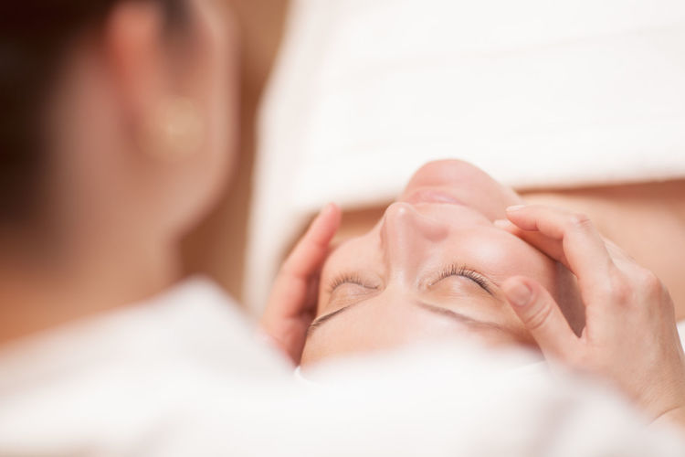 Young Woman Receiving Facial Massage In Spa