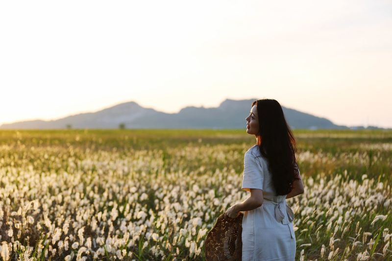 One Person Sky Field Young Adult Women Adult Young Women Beauty In Nature Land Lifestyles Nature Sunset
