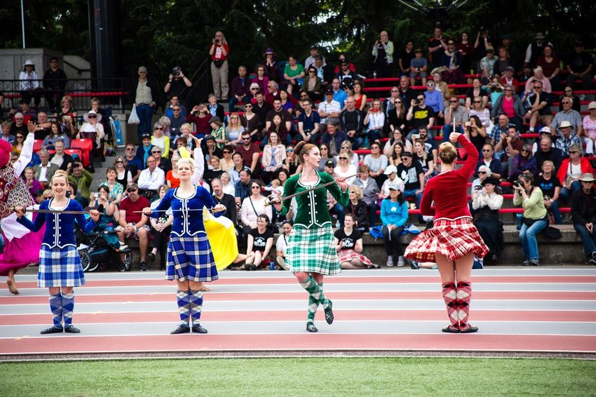 Highland Games Scotland Sport Blue Green Red Swords Dancing Kilt Scottish Dance Large Group Of People Outdoors Real People Running Track Sport Day Track And Field Competition Women Crowd
