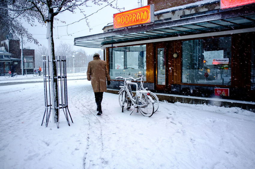 Rotterdam Architecture Beauty In Nature Building Exterior Built Structure Cold Temperature Day Frozen Full Length Land Vehicle Men Nature One Person Outdoors People Real People Snow Snowing Transportation Walking Warm Clothing Weather White Color Winter