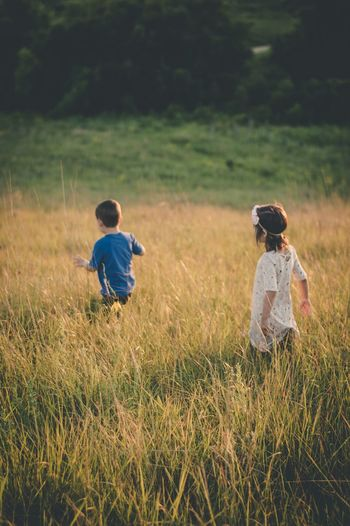 Kids adventure Childhood Grass Boys Field Child Two People Full Length Casual Clothing Nature Rear View Elementary Age Real People Playing Girls Children Only Growth Outdoors Togetherness Day Sky Minnesota Nature The Week On EyeEm Grass People