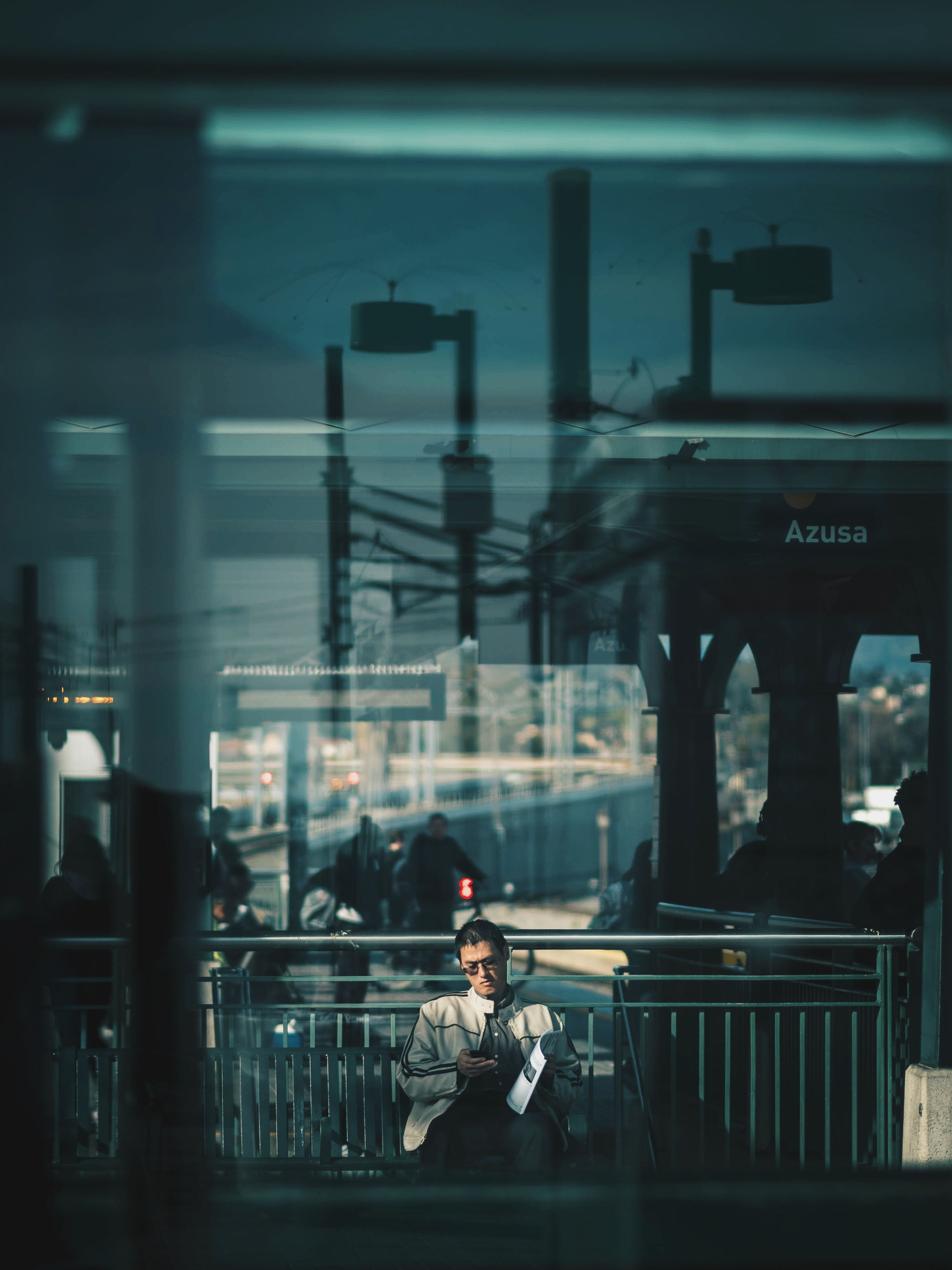 real people, connection, lifestyles, railing, bridge - man made structure, two people, architecture, waiting, women, built structure, sitting, transportation, indoors, building exterior, standing, full length, men, water, young women, young adult, illuminated, day, city, people