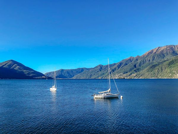 Lago Lago Maggiore Ascona Nautical Vessel Water Transportation Mode Of Transportation Mountain Sky Sea Beauty In Nature Copy Space Nature No People Scenics - Nature Blue Day Tranquility Waterfront Sailboat Rippled Sailing Tranquil Scene