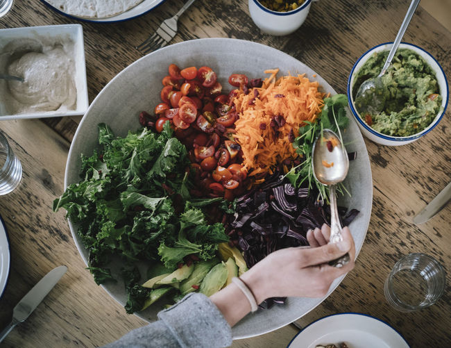 Salad Vegetarian Food Bowl Food Food And Drink Freshness Guacamole Healthy Eating High Angle View Human Hand Indoors  One Person Preparation  Preparing Food Ready-to-eat Real People Vegan Food Vegetable Wellbeing