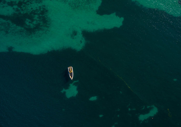 Aerial view of one boat in turquoise ocean water Copy Space Looking Down Aerial View Boat Ocean Shallow Top View Turquoise Water Water Fresh On Market 2017